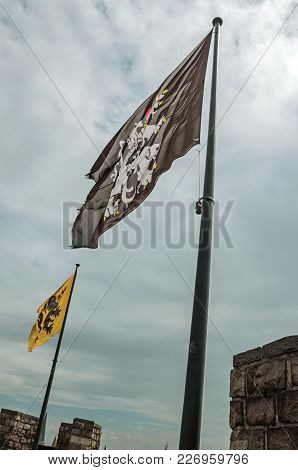 Flags And Cloudy Sky Seen On Top Of Tower Of Gravensteen Castle In Ghent. In Addition To Intense Cul