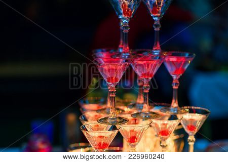 Martini Glasses With Cherries With Red Bright Illumination For A Party