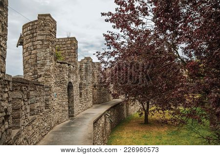 Gravensteen Castle Walls And Balustrade Overlooking A Backyard In Ghent. In Addition To Intense Cult