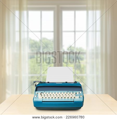 Concept Image Of Working From Home With Electric Typewriter On Desk In Front Of Bright Summer Window