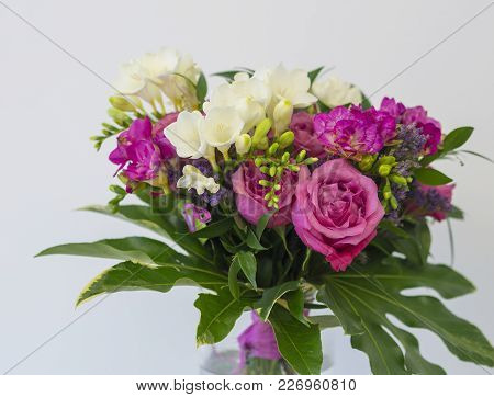 Close Up Pink Rose And White Freesia Flower Bouquet With Green Leaves, Decorative Floral Arangement