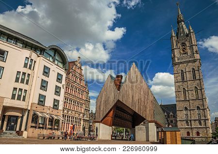 Ghent, Northern Belgium - July 03, 2017. Old And Modern Building Beside Gothic Clock Tower And Blue