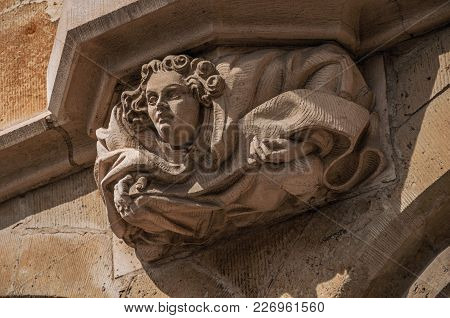 Close-up Of Decorative Sculpture In Human Format On A Gothic Building In Ghent. In Addition To Inten