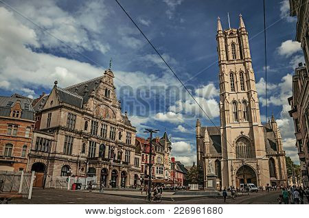 Ghent, Belgium - July 03, 2017. People, Buildings And Gothic Cathedral In Ghent. In Addition To Inte