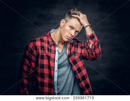Male Vogue Model Touching His Hair. Studio Portrait On Dark Grey Background.