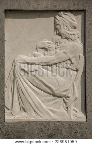 Ghent, Northern Belgium - July 03, 2017. Detail Of Of Mother And Son Engraved On Marble In Monument