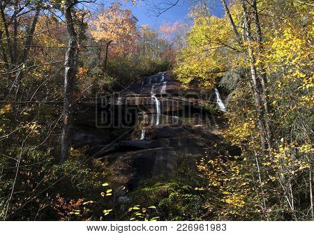 Streams Of Water Flow Across The Rocky Landscape Of Southern North Carolina In The Pisgah Forest In