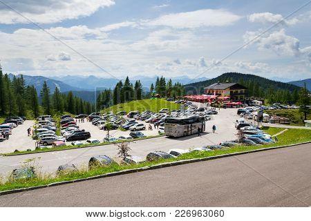 Ramsau Am Dachstein, Austria - August 17 2017: Parking Lot At Alps Mountains Under Dachstein Glacier
