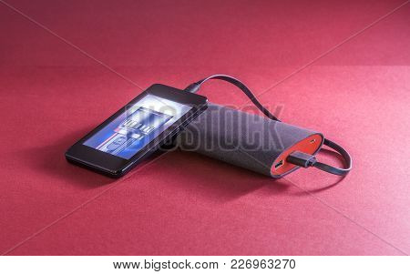 Powerbank On Red Background