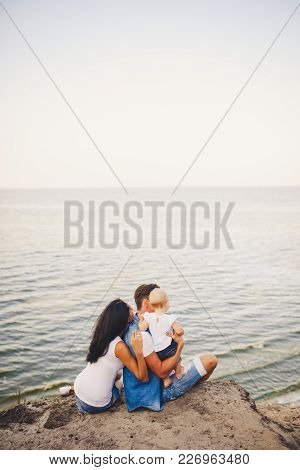 Theme Family Vacation With Small Child On The Nature And Sea. Mom, Dad And Daughter Of One Year Are