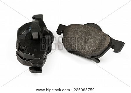 New Car Brake Pads Isolated On White. Set Of Spare Brake Pads For One Wheel.