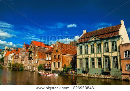 Ghent, Belgium - July 03, 2017. Old Buildings In Front Of The Canal, With Boats In Ghent. In Additio