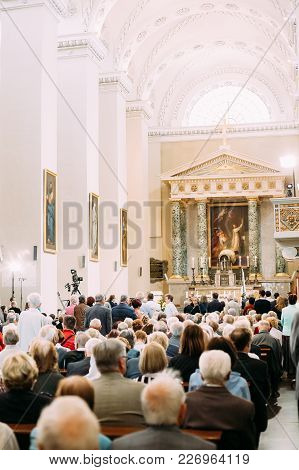 Vilnius, Lithuania - July 6, 2016: People Parishioners Pray In Cathedral Basilica Of Saints Stanisla