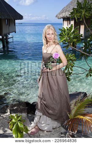 Beautiful Woman With A Rose Near A Sea, Tahiti
