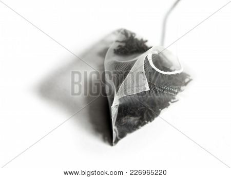 Single bag of elite tea in silk fabric packing. Small depth of sharpness.