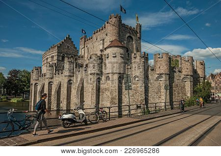 Ghent, Belgium - July 03, 2017. Bridge And People In Front Gravensteen Castle In Ghent. In Addition