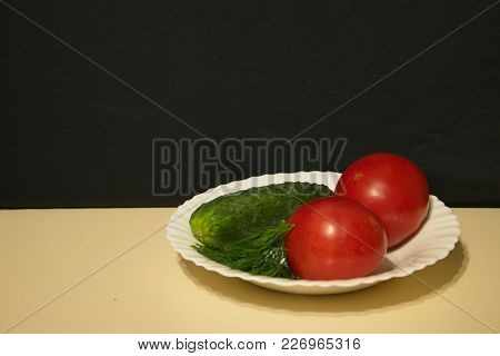 Cucumbers And Tomatoes In A Plate Light Tabl Dark Background