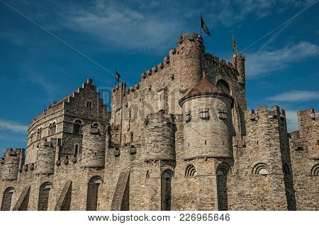 Close-up O Stone Wall And Watch-tower Of The Gravensteen Castle In Ghent. In Addition To Intense Cul