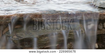 Waterfall With Rock And Stone With Water Flowing Over Top