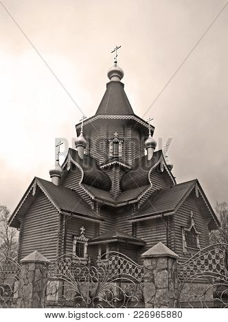 Wooden Russian Orthodox Church With Domes And Crosses Behind  Stone Fence In Style  Black And White