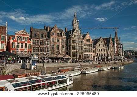 Ghent, Belgium - July 03, 2017. Old Buildings In Front Of The Canal With Boats In Ghent. In Addition