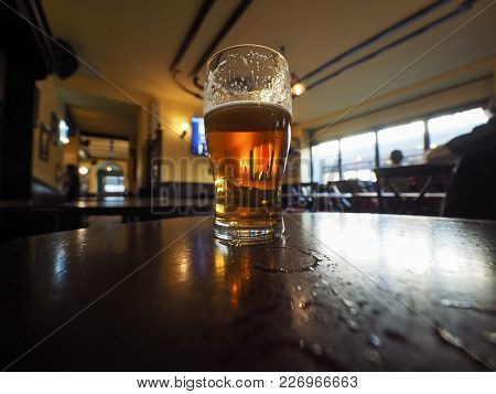 A Pint Of British Ale Beer In A Pub Selective Focus On Glass