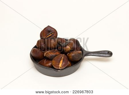 Roasted Chestnuts On The Pan Isolated On White Background
