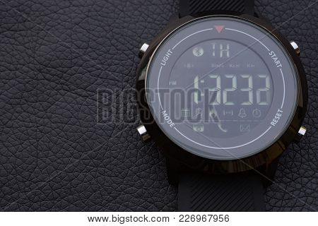 Macro Closeup Shot Of Stylish Sport Smart Watch On Black Leather. Low Key Shot