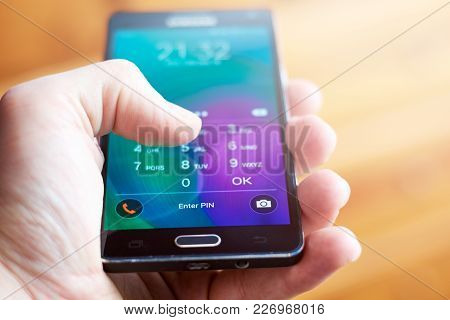 Buenos Aires, Argentina - February 15, 2018: A Person Holding A Mobile Phone And Entering The Securi