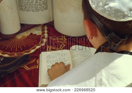 Jerusalem, Israel - August 25, 2016: A Rear View Of Praying Young Man Hand With A Tefillin Holding A