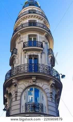 The Typical Facade Of Parisian Building, France.