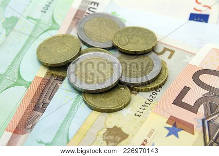 Assorted Pile Of Euro Coins And Banknotes / Bills