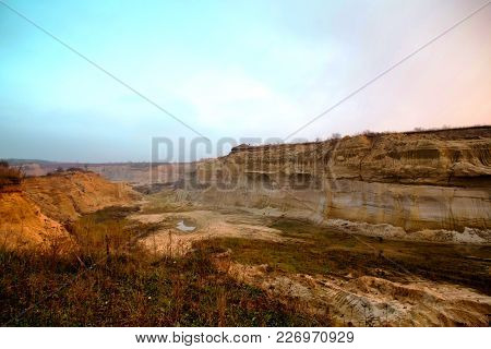 Sand Mining Quarry In Ukraine. Deep Plumage. Sunset In The Fog Over The Quarry