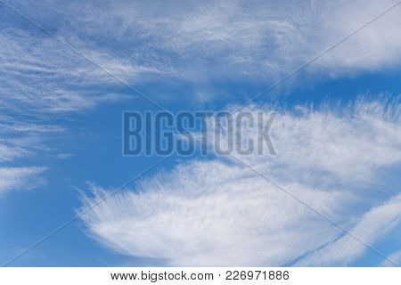 Blue Sky And Disheveled Fringed Clouds During A Strong Wind With Hurricane Force