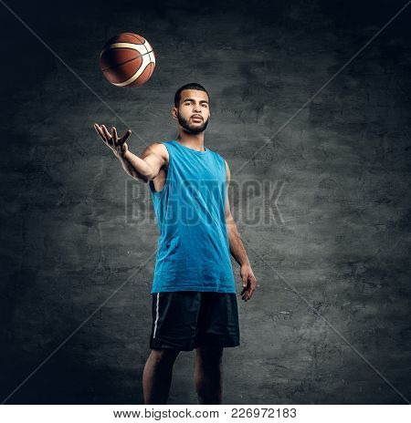 Full Body Studio Portrait Of A Black Basketball Player Playing With A Ball.