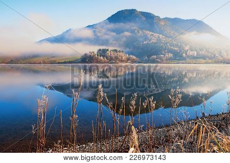 Peaceful Morning At Lake Schliersee, Reflecting Mountain And Fog. Bavarian Landscape