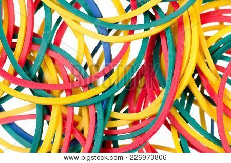 Stationery Multicolored Rubber Bands On A White Background, Top View