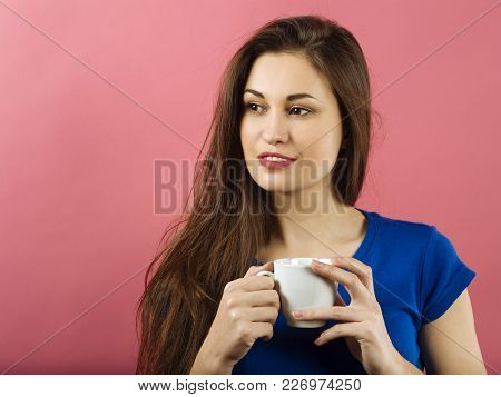 Photo Of A Very Attractive Lady In Her Twenties Drinking Coffee.