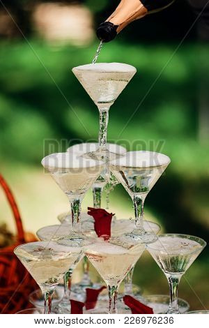 Pyramid Of Champagne Glasses For A Festive Party Is Filled From The Bottle
