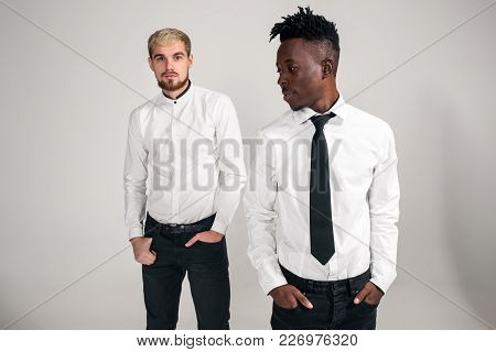 International Friendship Concept. Studio Shot Of Two Stylish Young Men: Handsome Bearded Young Man I