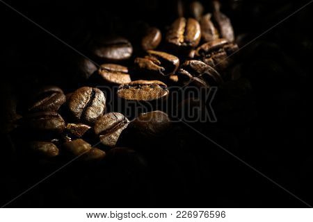 Coffee Beans Background.  Brown Texture Of Roasted Coffee Seeds Filling All Frame.  Space For Copy T