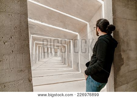 Rear View On Caucasian Man In Casual Clothes Standing, Peek And Thinking About Future And Choice Of
