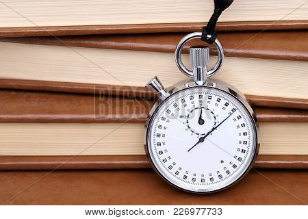 Analogue Metal Stopwatch With Old Book Background