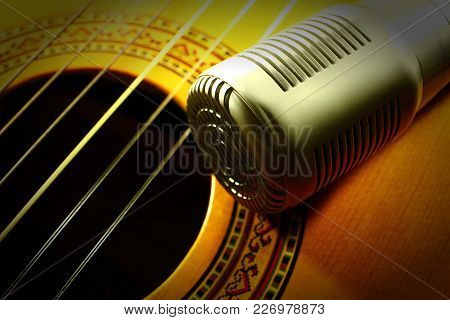 Professional Condenser Studio Microphone, Closeup Of Playing Guitar, Musical Instrument Concept.