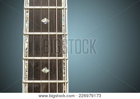 Close Up Macro Of Guitar Strings And Fret Board.