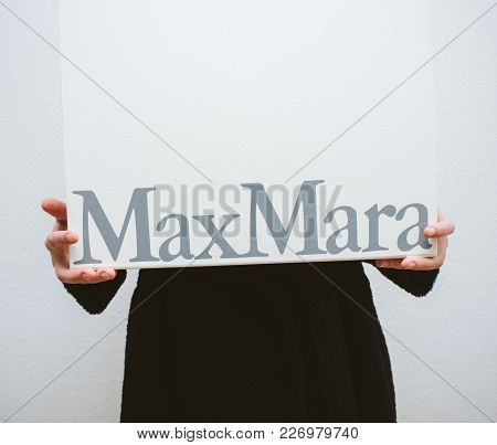 Paris, France - Feb 16, 2018: Detail Of Elegant Fashionista Woman Holding Max Mara Italian Cardboard