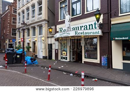Amsterdam, Netherlands - June 25, 2017: Uncleaned Garbage On The One Of The Central Amsterdam Street