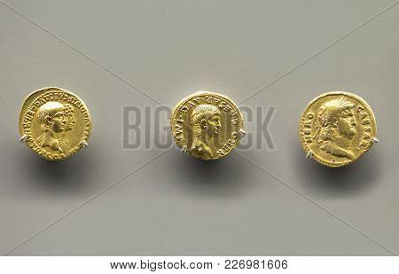 Merida, Spain - December 20th, 2017: Three Golden Coins Of Nero Emperor At National Museum Of Roman