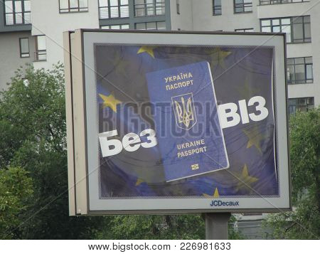 Kharkov, Ukraine - Summer 2017: Billboard With A Picture Of A Ukrainian Passport On The Background O