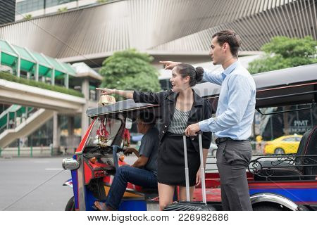 Bangkok,thailand - May 13, 2017: Editorial Of Unidentified Thai Tuk Tuk Taxi Drop Two Caucasian Busi